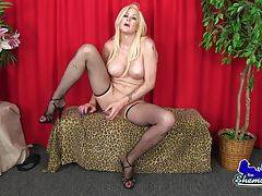 Blonde bombshell fingers herself and strokes her hard cock!