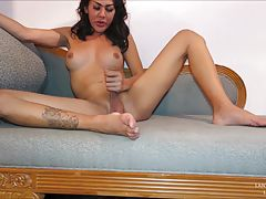 Get to know Lanta a little better before she shows off her beautiful Ladyboy bod! Lanta is`t shy about her panties peeking from under her mini skirt. Off goes her dress and Lanta is stroking her smooth cock and fondling her ample tits. Lanta loves anal pl