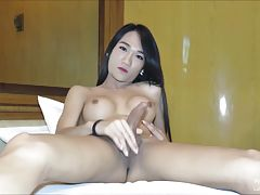 Slim and busty Pie strokes her magnificent Ladyboy stick until she pops! Pie`s creamy skin is flawless and slender thighs open to show her hard girl-cock. Pie toys with her asshole while pumping her meat. A big rope of cum splashes Pie`s tight tummy as sh