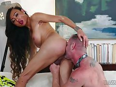 Statuesque, Asian TS beauty, Venus shows D. Arclyte who`s boss when she dominates him on his couch. D. Arclyte worships Venus` stiff cock, slobbering all over her knob until Venus can`t take it anymore. She drives her hard cock into D. Arclyte`s asshole,