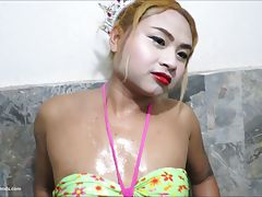 Play a game of cards with Chan. The loses has to cum for the winner! Chan doesn`t play very well and soon has to take off her slutty green dress. Next blonde Chan goes into the shower in a bikini. She`s wearing a tiara and her thick bod sprayed with water