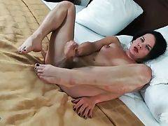 Pretty she-male is sensually rubbing her craving cock.