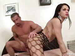 Turned on stud stuffs his boner inside she-male`s asshole.