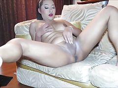 Enjoy a private show as Cake opens her thighs wide to jerk off. Cake takes off her dress and white panties and lays back on the couch. Her soft womanly bod is capped by an erect cock ready for action. Cake caresses her nipples, and plays with her asshole