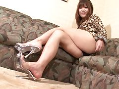 The beautiful and gorgeous Rifana Koda in a lovely cheetah inspired dress smiles and strikes some hot poses on the couch. She then starts showing off her goodies and her big round tits came out and they look very tasty then she pulls out her rock hard coc