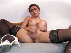Pierced nose Miley strokes her long stiff cock! Miley`s cock is stiff and proud as it points straight up. She`s wearing just heels and black stockings and Miley`s tits look fantastic. Watch Miley masturbate and delivery her sticky girl-load.