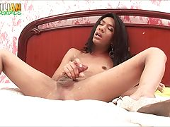 Slender transgirl Luanna Oliver gets naked on the bed, fucks her ass with her favourite dildo and jacks-off her cum over herself in this scene.