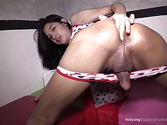 She takes the cock from her ass and gives an ATM blowjob.
