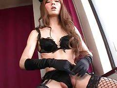 Hot looking Asian she-male Lisa teases her eager dong.