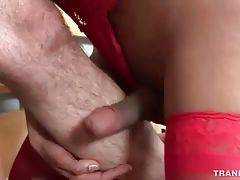 Guy facefucks slutty she-male and fingers her asshole.