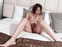 Sexy ladyboy Manami Cyojyo passionately rubs her cock.