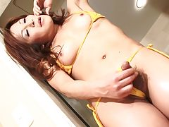 Miwa has plenty of nice things to show and we�re ready to watch her display it. She starts her scene in her new yellow bikini, then undresses to expose her very large and throbbing cock. Watch her whips her cock out and strokes it hard for you.