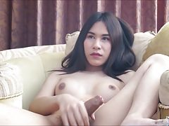 Pla has a short interview with Amy, then strokes her fat cock in a swank Pattaya hotel. Pla has braces and a miniskirt, and caresses her growing dick-clit. With her legs in the air you can see Pla`s slightly furry backdoor as she jerks off. Pla plays with