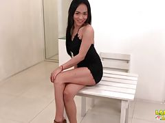 Soda is here and this naughty looking ladyboy is naturally seductive, not to mention those gorgeous natural body of hers! She starts her debut scene with a sensual strip tease in front of a small table, fondling her curves and bulge before straddling the